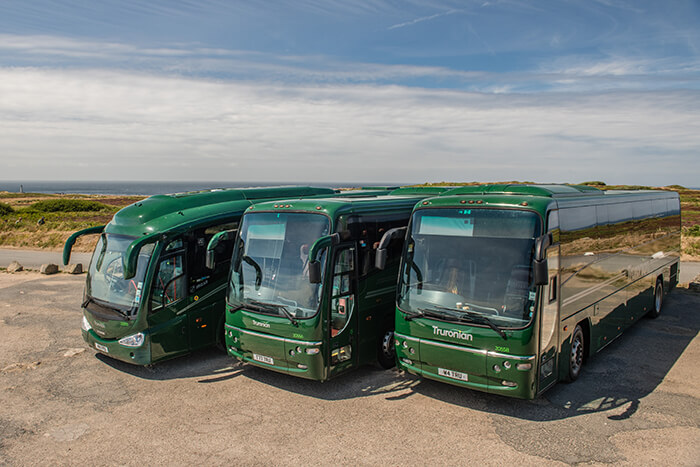 Truronian coaches lined up in front of an endless sky